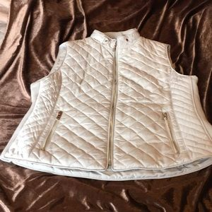 Cream colored quilted vest with gold hardware
